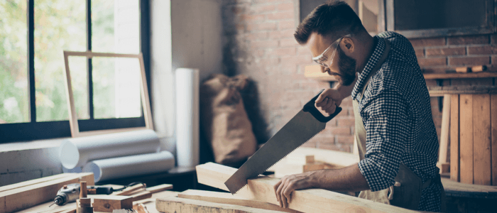 A carpenter with tennis elbow. Carpentry is one of the lesser known causes of tennis elbow.